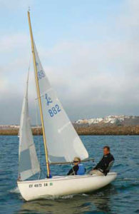 Captains Stu and Shari sailing their vintage 1963 Lido in the South Coast Corinthina Yacht Club Sunstroke Series